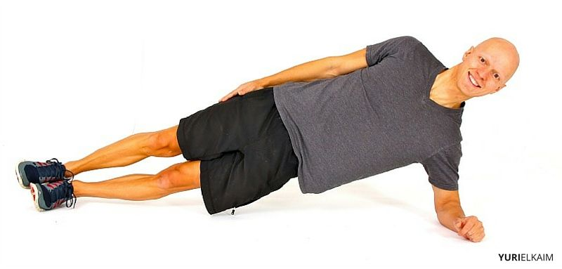 Yuri Elkaim doing a side plank