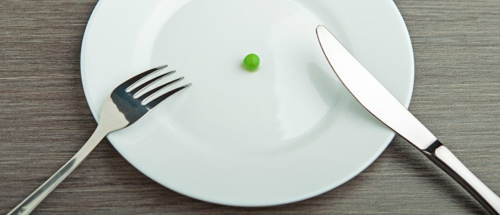 Empty plate with a pea on it