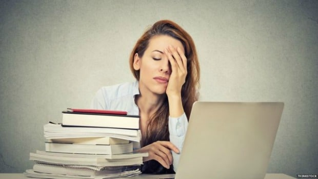 Woman stressed out in front of laptop