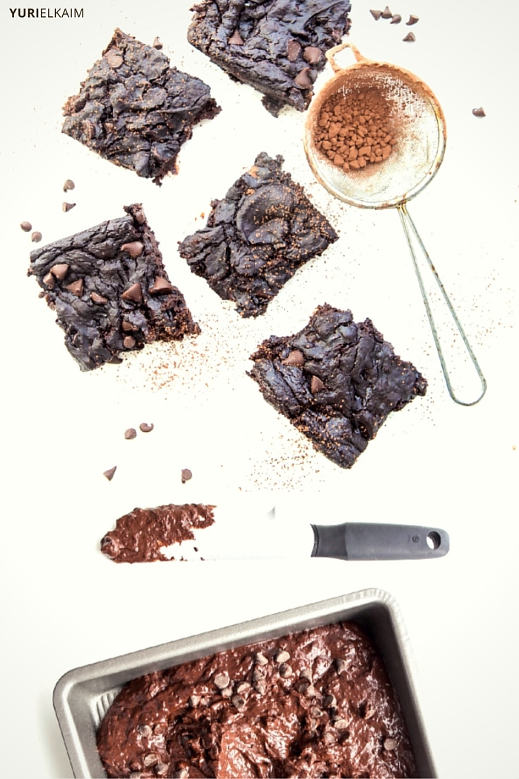 Black Bean Brownie squares and dough in a pan