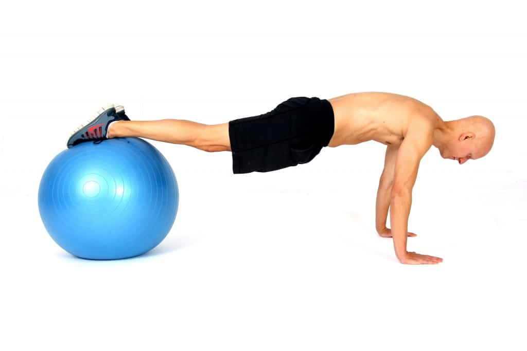 The 14 Best Ab Exercises - Plank with Feet on Ball