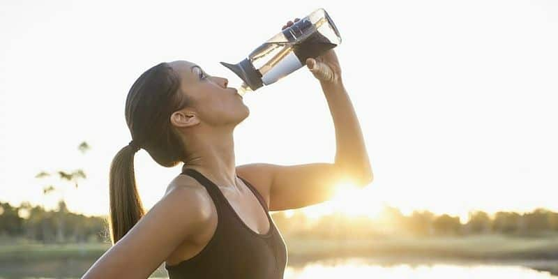 Woman working out and drinking water