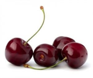 Four cherries with a white background