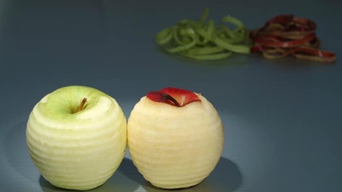 Two apples with skins peeled
