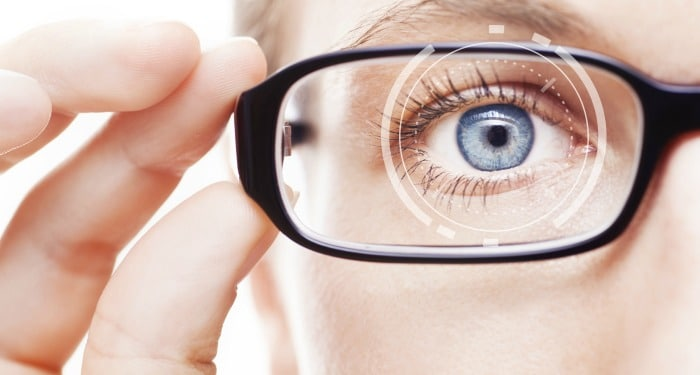 woman looking through eye glasses