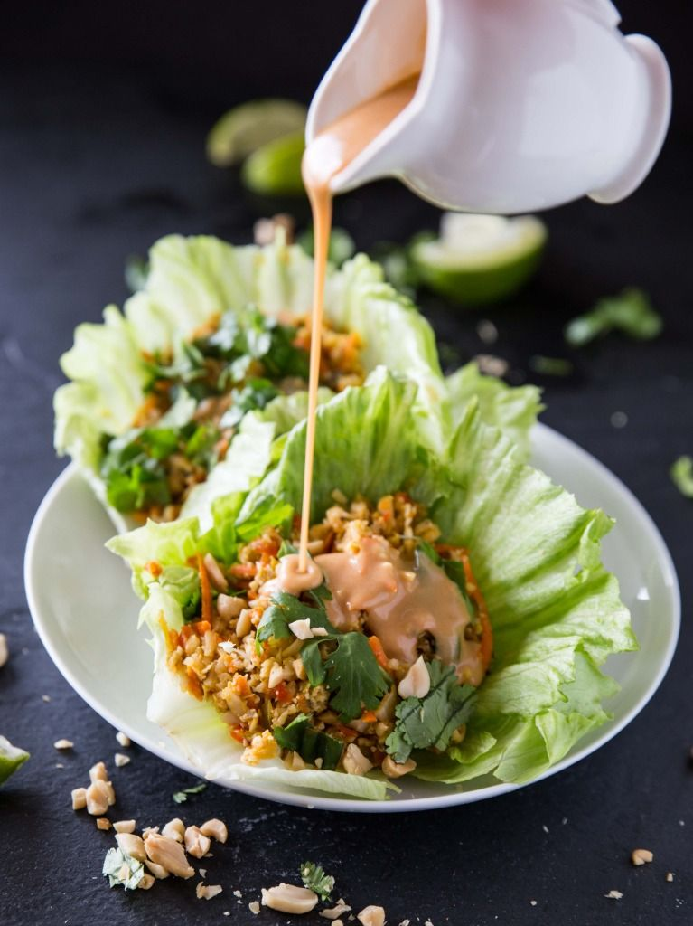 Cauliflower Rice Lettuce Cups with Sriracha Peanut Sauce via Veggie and the Beast