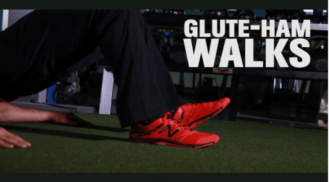 Glute Hamstring Walkout via Men's Health