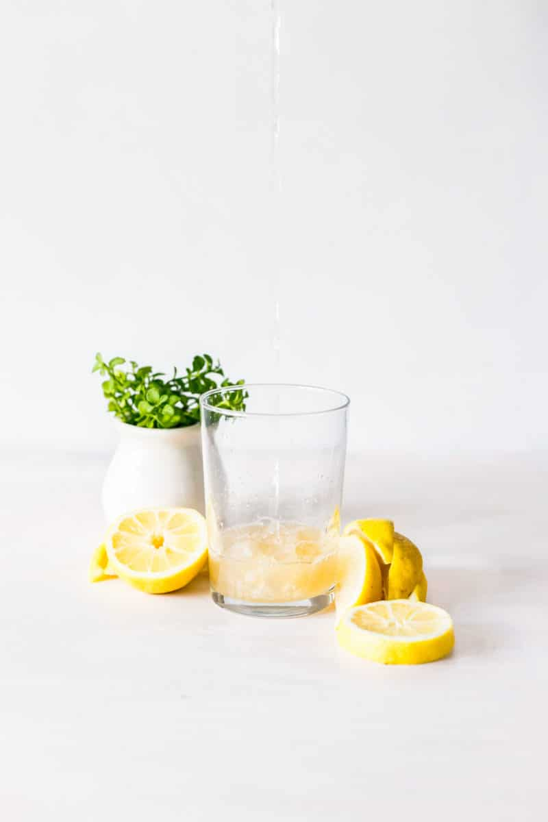 Sliced Lemons with a Glass of Lemon Water